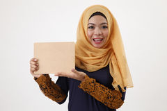 Woman holding wooden board Royalty Free Stock Photography