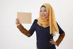 Woman holding wooden board Royalty Free Stock Image