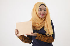 Woman holding wooden board Stock Photos