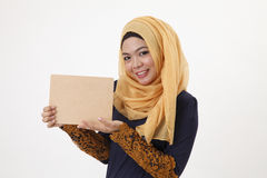 Woman holding wooden board Royalty Free Stock Photo