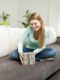 Woman holding wooden bricks with letters making word Love Stock Photography