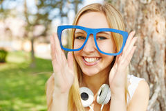 Woman holding wooden nerd glasses Stock Photo