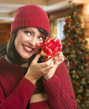 Woman Holding Wrapped Gift in Christmas Setting Royalty Free Stock Photo
