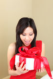 Woman Holding a Wrapped Gift Package Royalty Free Stock Photo