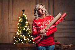 Woman holding wrapping kraft paper for gifts Stock Photo