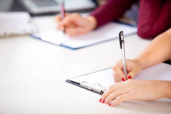 Woman holding a written examination Royalty Free Stock Photos