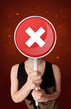 Woman holding x sign Stock Photography