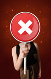 Woman holding x sign Royalty Free Stock Image