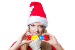 Woman holding Xmas text Stock Image