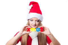 Woman holding Xmas text Royalty Free Stock Image