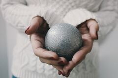 Woman holding Xmas tree bauble Royalty Free Stock Image