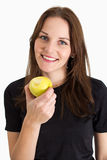 Woman Holding A Yellow Apple And Smiling Stock Images