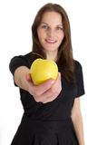 Woman Holding A Yellow Apple And Smiling. At The Camera Stock Photography