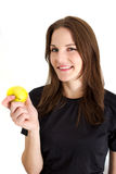 Woman Holding A Yellow Apple And Smiling. At the camera Stock Photo