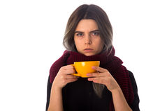 Woman holding a yellow cup Stock Photo