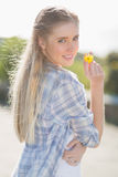 Woman holding yellow flower in hand royalty free stock images