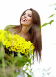 Woman holding yellow flowers Royalty Free Stock Photos
