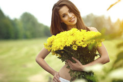Woman holding yellow flowers Stock Photography
