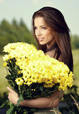 Woman holding yellow flowers Royalty Free Stock Photo