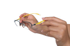 Woman holding yellow glasses in hands Stock Photography