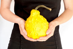 Woman holding a yellow gourd Stock Photos