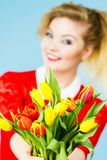 Woman holding yellow and orange bouquet of tulips Stock Photography