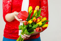 Woman holding yellow and orange bouquet of tulips Stock Image