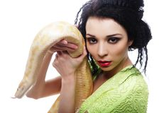 woman holding yellow Python Royalty Free Stock Image