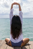 Woman holding a yoga position Royalty Free Stock Photo