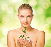 Woman holding young plant. Beautiful young woman holding young plant Royalty Free Stock Image