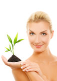 Woman holding young plant Stock Photos