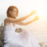 Woman holding zen stones in hand. Royalty Free Stock Photography