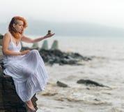 Woman holding zen stones. Stock Image