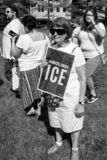 Woman Holds Abolish Ice sign at Immigration Rally. Immigration Rally held in Columbus Ohio on 06/30/18. Part of the nationwide rallies to protest Trump stock photography