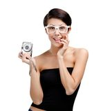 Woman holds amateur hand-held  silver camera Royalty Free Stock Photo