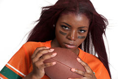 Woman holds american football ball Stock Photography