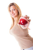 Woman holds apple fruit and measuring tape Stock Photo