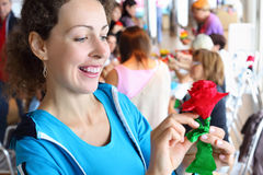 Woman holds artificial red rose Stock Photos