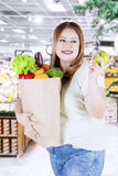 Woman holds a bag with vegetables Stock Image