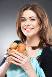 Woman holds a basket with easter eggs Stock Photography