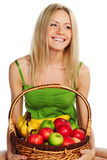Woman holds a basket of fruit. On a white background Stock Image
