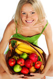 Woman holds a basket of fruit. On a white background Stock Photo