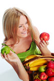 Woman holds a basket of fruit Stock Image