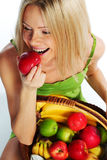 Woman holds a basket of fruit Stock Photography