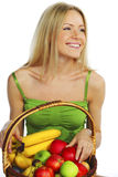 Woman holds a basket of fruit Stock Photos