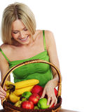 Woman holds a basket of fruit Royalty Free Stock Photos