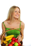 Woman holds a basket of fruit Royalty Free Stock Images