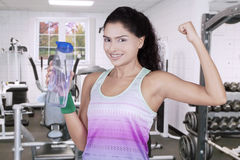 Woman holds beverage at gym Royalty Free Stock Photos