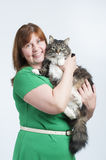 A woman holds a big fluffy cat. Royalty Free Stock Photography