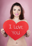 Woman holds big red heart i love you in her hands Royalty Free Stock Photography